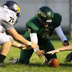 Neuqua Valley's Matthew Appel (71) gets to a loose ball before Waubonsie Valley's Ethan Nelson (2).
