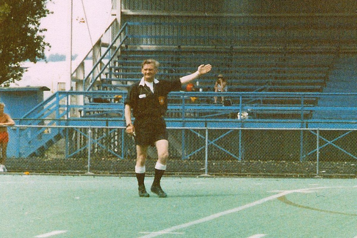 """National Soccer Hall of Famer George """"Whitey"""" Craggs officiating at Renton Stadium, ca 1980"""