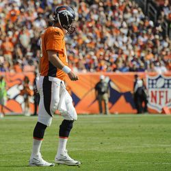Denver Broncos quarterback Peyton Manning (18) walks off the field in the second quarter of an NFL football game against the Houston Texans, Sunday, Sept. 23, 2012, in Denver.