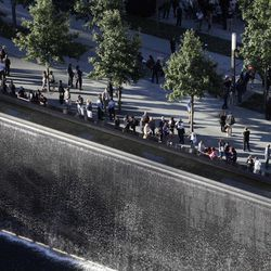 Friends and families of victims of the Sept. 11, 2001, terror attacks, look over a reflecting pool during a ceremony at the National September 11 Memorial, Tuesday, Sept. 11, 2012 in New York. As in past years, thousands are expected to gather at the World Trade Center site in New York, the Pentagon and Shanksville, Pennsylvania, to read the names of nearly 3,000 victims killed in the worst terror attack in U.S. history.