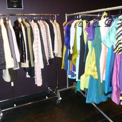 The Chanel rack on the left and the color block frocks on the right