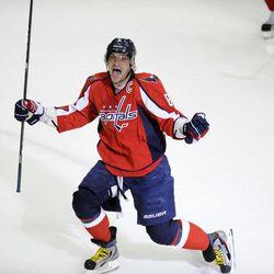 Washington Capitals left wing Alex Ovechkin (8), of Russia, celebrates his goal against the Boston Bruins during the third period of Game 6 of an NHL hockey Stanley Cup first-round playoff series, Sunday, April 22, 2012, in Washington.