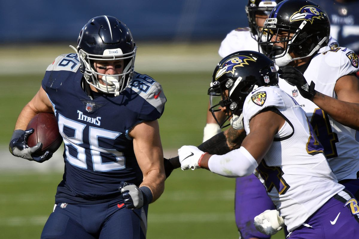 Tennessee Titans tight end Anthony Firkser (86) is tackled by Baltimore Ravens cornerback Marlon Humphrey (44) and picks up a first down during the Tennessee Titans game against the Baltimore Ravens.