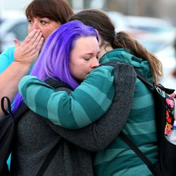 Pleasant Grove High School students Kalie Nutt and Taryn Miller, both 11th-graders, hug after a lockdown at the high school was lifted Thursday, Dec. 3, 2015. Pleasant Grove High School was placed on lockdown after receiving reports of a man with a weapon inside the school. Karyn's mother, Camie Miller, wipes away her tears.