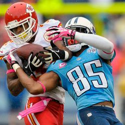 Oct 6, 2013; Nashville, TN, USA; Kansas City Chiefs cornerback Marcus Cooper (31) intercepts a pass intended for Tennessee Titans wide receiver Nate Washington (85) during the second half at LP Field. The Chiefs won 26-17.
