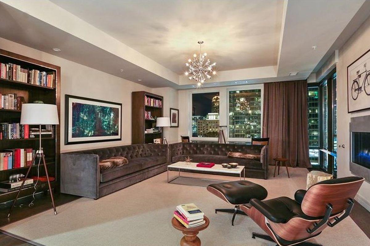 A photo of the living room of a $1.7M Atlanta condo at night.