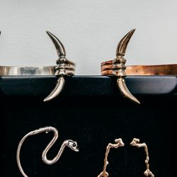 "The <a href=""http://laurabusony.bigcartel.com/product/snake-ear-cuff"">Sap Ear Cuff</a> (bottom left, $175) and the <a href=""http://laurabusony.bigcartel.com/product/johai-earrings"">Johai Earrings</a> ($115)"