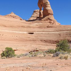 Here's Lee Benson's photo of Delicate Arch taken at noon.