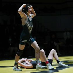Payson's Aaron Garcia celebrates winning the 106-pound championship during 5A boys wrestling at Wasatch High in Heber on Thursday, Feb. 18, 2021.