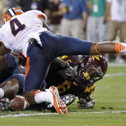 Illinois defensive back Patrick Nixon-Youman (4) dives on Arizona State running back Cameron Marshall (6) as Marshall fumbles on the goal line during the first half of an NCAA college football game, Saturday, Sept. 8, 2012, in Tempe, Ariz.
