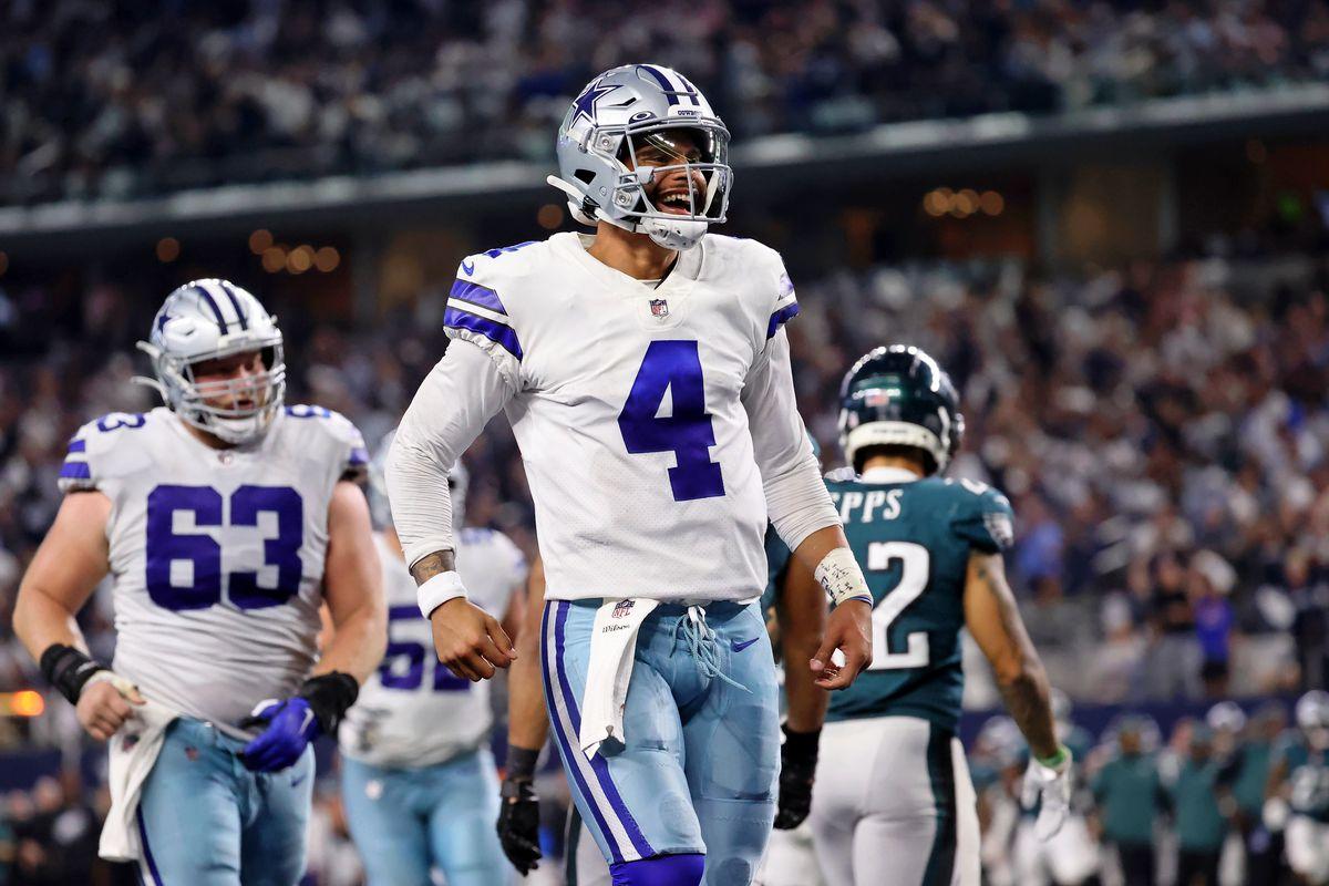 Dallas Cowboys quarterback Dak Prescott (4) celebrates after making a touchdown pass to tight end Dalton Schultz (not pictured) against the Philadelphia Eagles during the fourth quarter at AT&T Stadium.