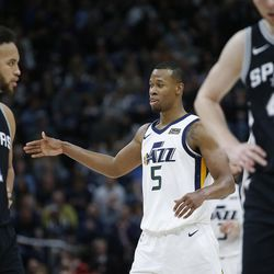 Utah Jazz guard Rodney Hood (5) high-fives a teammate after hitting a three in Salt Lake City on Thursday, Dec. 21, 2017. Utah won 100-89.