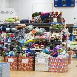 The 19th annual Candy Cane Corner holiday store prepares to open in the old Granite High School pool building in South Salt Lake on Monday, Nov. 30, 2015.