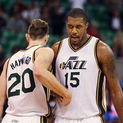 Gordon Hayward (20) and Derrick Favors (15) of the Utah Jazz celebrate their win over Memphis during NBA basketball at Vivint Arena in Salt Lake City, Saturday, Nov. 7, 2015.