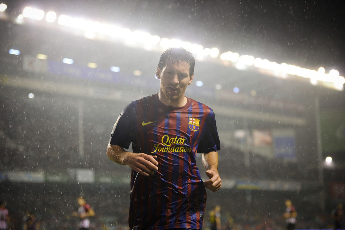BILBAO, SPAIN - NOVEMBER 06:  Lionel Messi of FC Barcelona looks on under a rain storm during the La Liga match between Athletic Club and FC Barcelona at San Mames Stadium on November 6, 2011 in Bilbao, Spain.  (Photo by David Ramos/Getty Images)