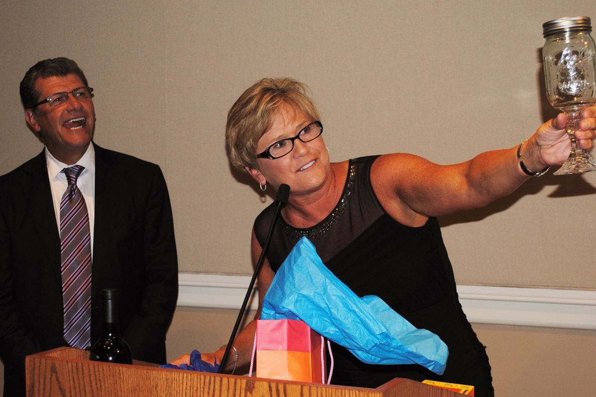 One of the two gifts Holly Warlick presented Geno Auriemma at the Women's Basketball Hall of Fame was a pair of stemmed wine glasses with Mason jars affixed.