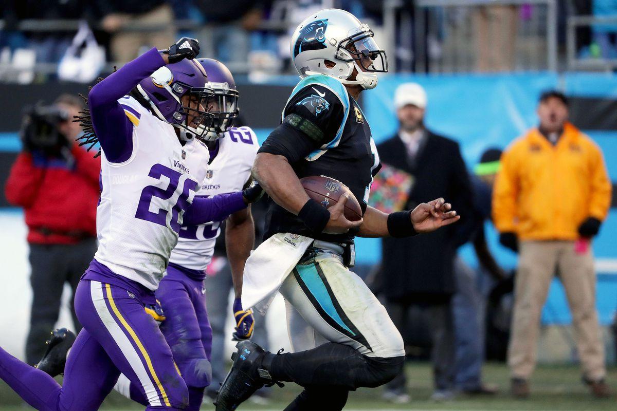 Cam Newton runs the ball against the Vikings