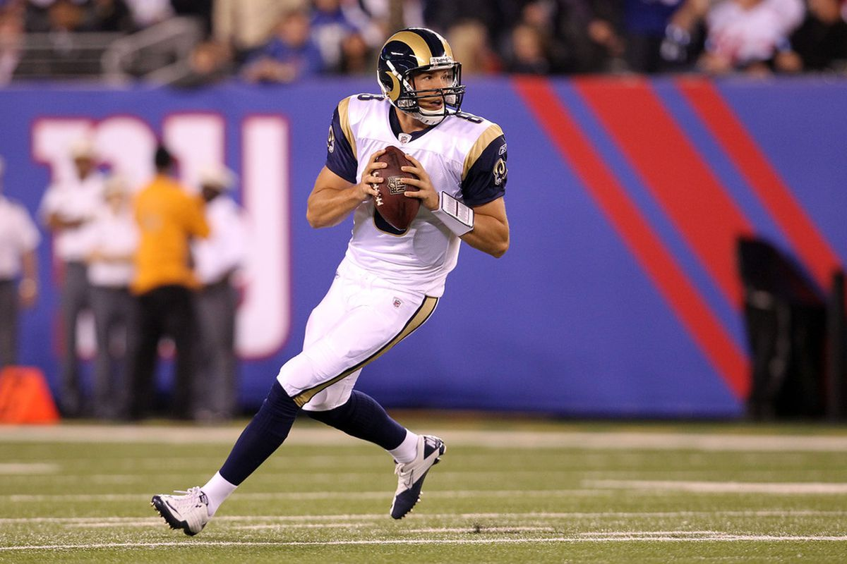 EAST RUTHERFORD, NJ - SEPTEMBER 19:  Sam Bradford #8 of the St. Louis Rams rolls out turnover pass against the New York Giants at MetLife Stadium on September 19, 2011 in East Rutherford, New Jersey.  (Photo by Al Bello/Getty Images)