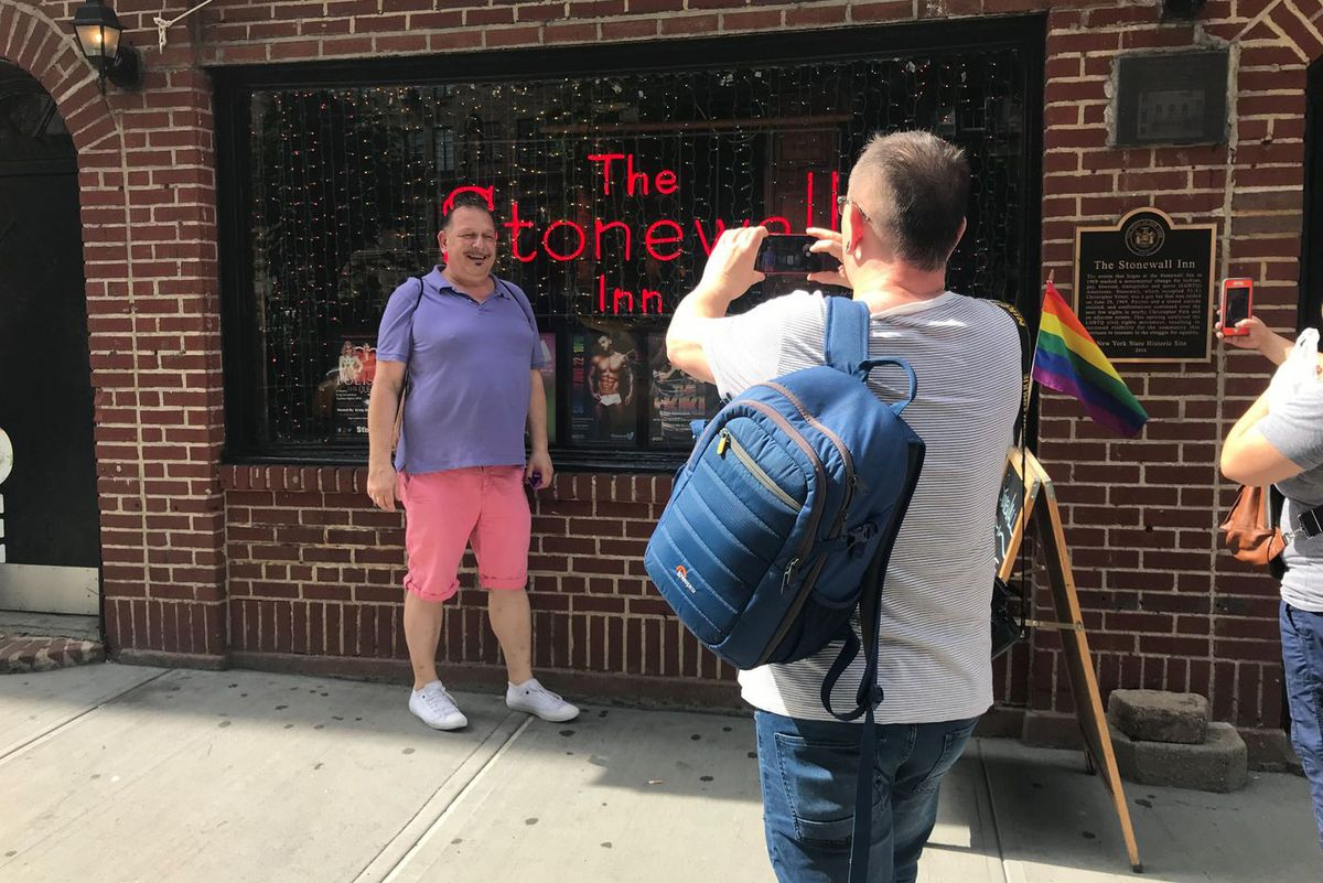 Klaus (right) and Harald Frimmel-Walser take pictures in front of The Stonewall Inn in Greenwich Village, on June 25, 2019.