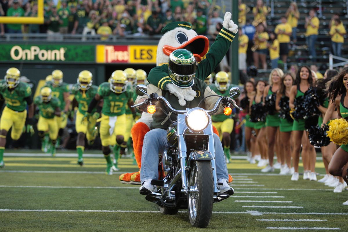 DeAnthony Thomas might be able to outrun the motorcycle. At least, it looked that way during the Arkansas State game Saturday night. (Credit: Scott Olmos-US PRESSWIRE)