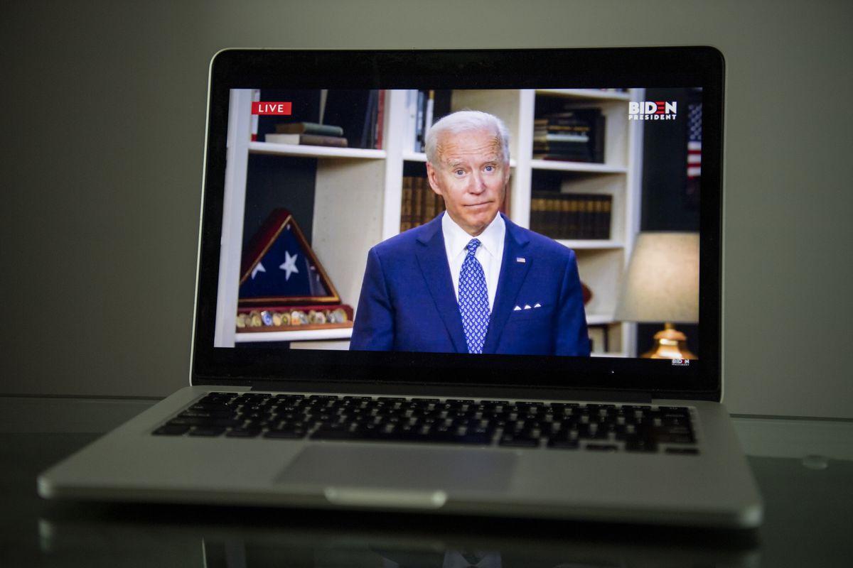 Joe Biden appears on a computer screen.