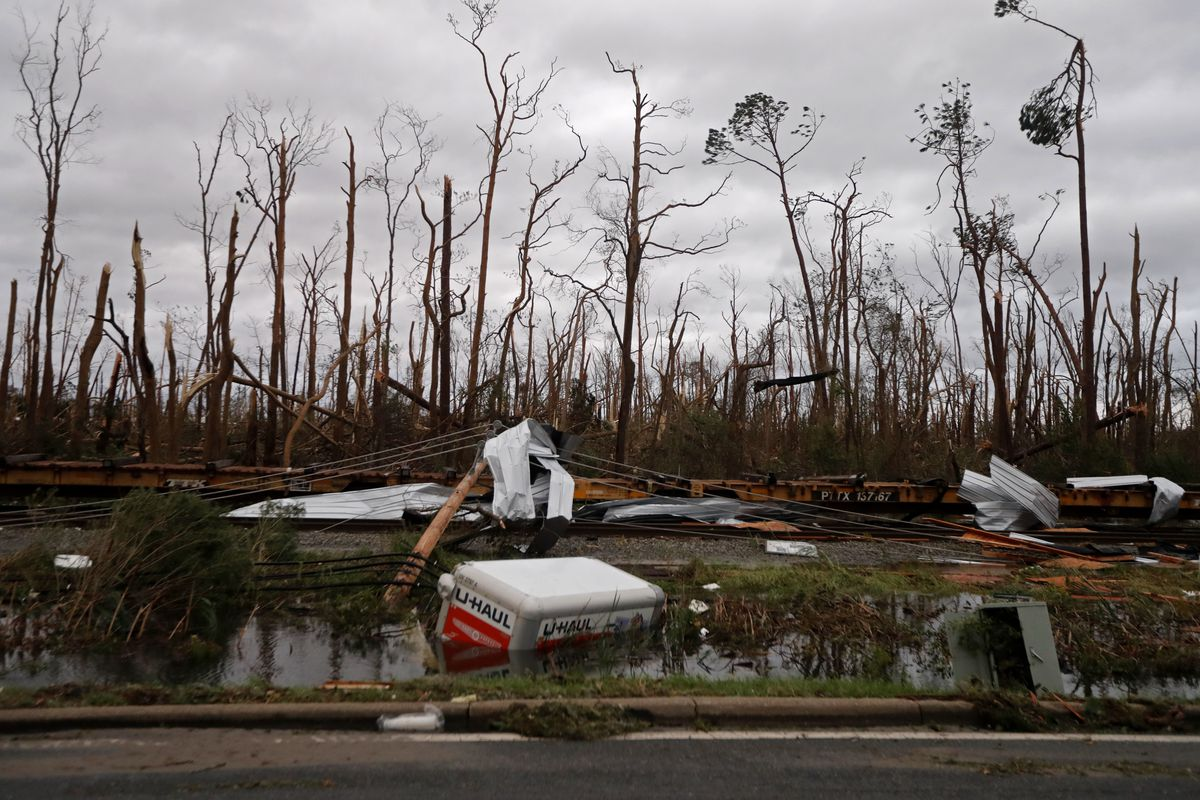 Shredded trees, derailed train cars and a sunken trailer are seen in the aftermath of Hurricane Michael in Panama City, Fla., Wednesday, Oct. 10, 2018.