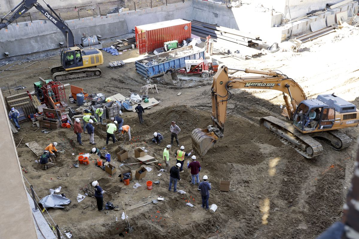An aerial view of workers excavating coffins from a construction site in the Old City neighborhood in Philadelphia.