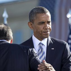President Barack Obama walks past Defense Secretary Leon Panetta as he moves to the podium to speak at the Pentagon Memorial, Tuesday, Sept. 11, 2012, during a ceremony to mark the 11th anniversary of the Sept. 11 attacks.