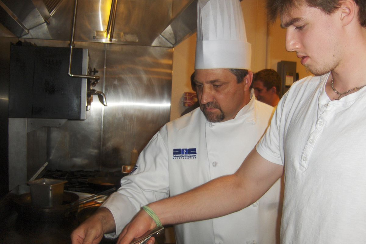Chef Ditri works with the Jackets' prospects during the cooking classes last summer.