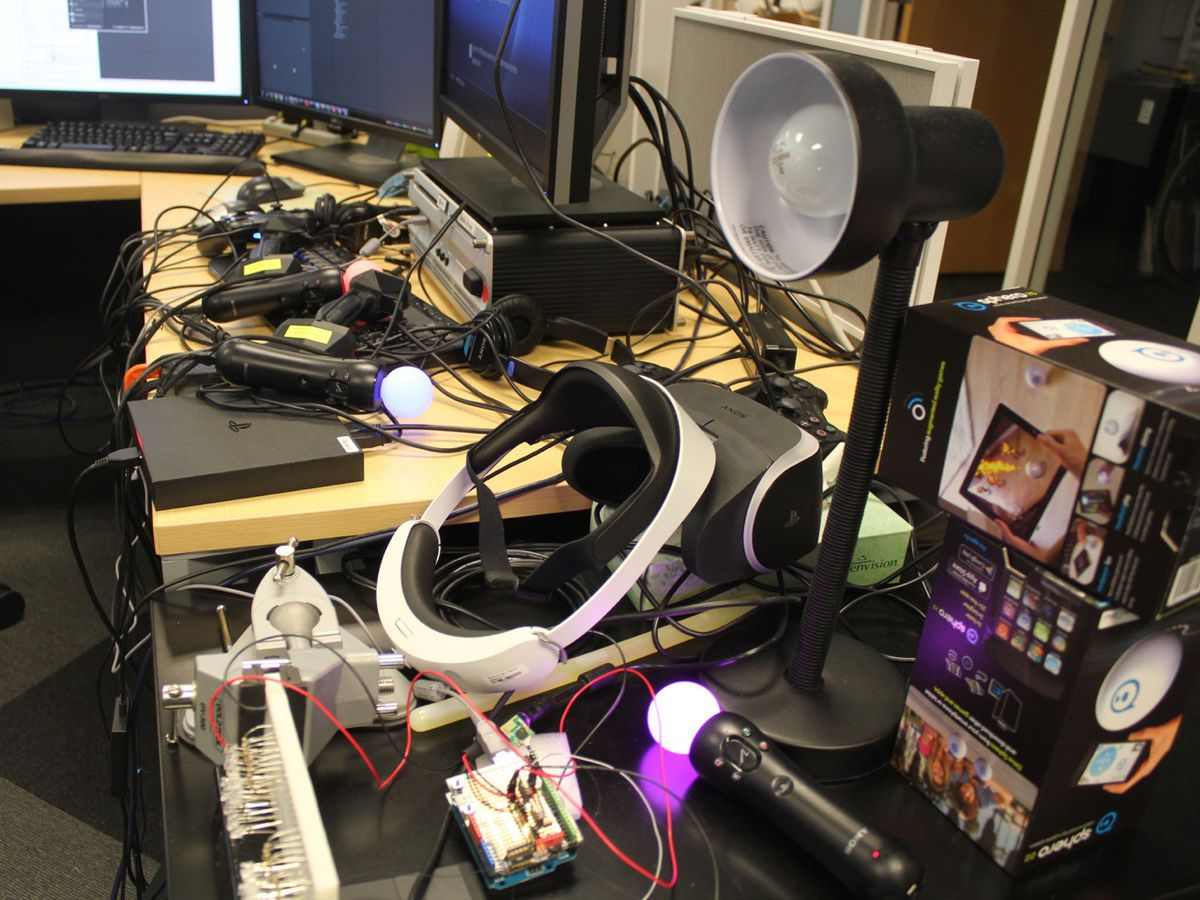 The desk where Osman configured a flying robot to work with the PS4 controller is a tad messy.