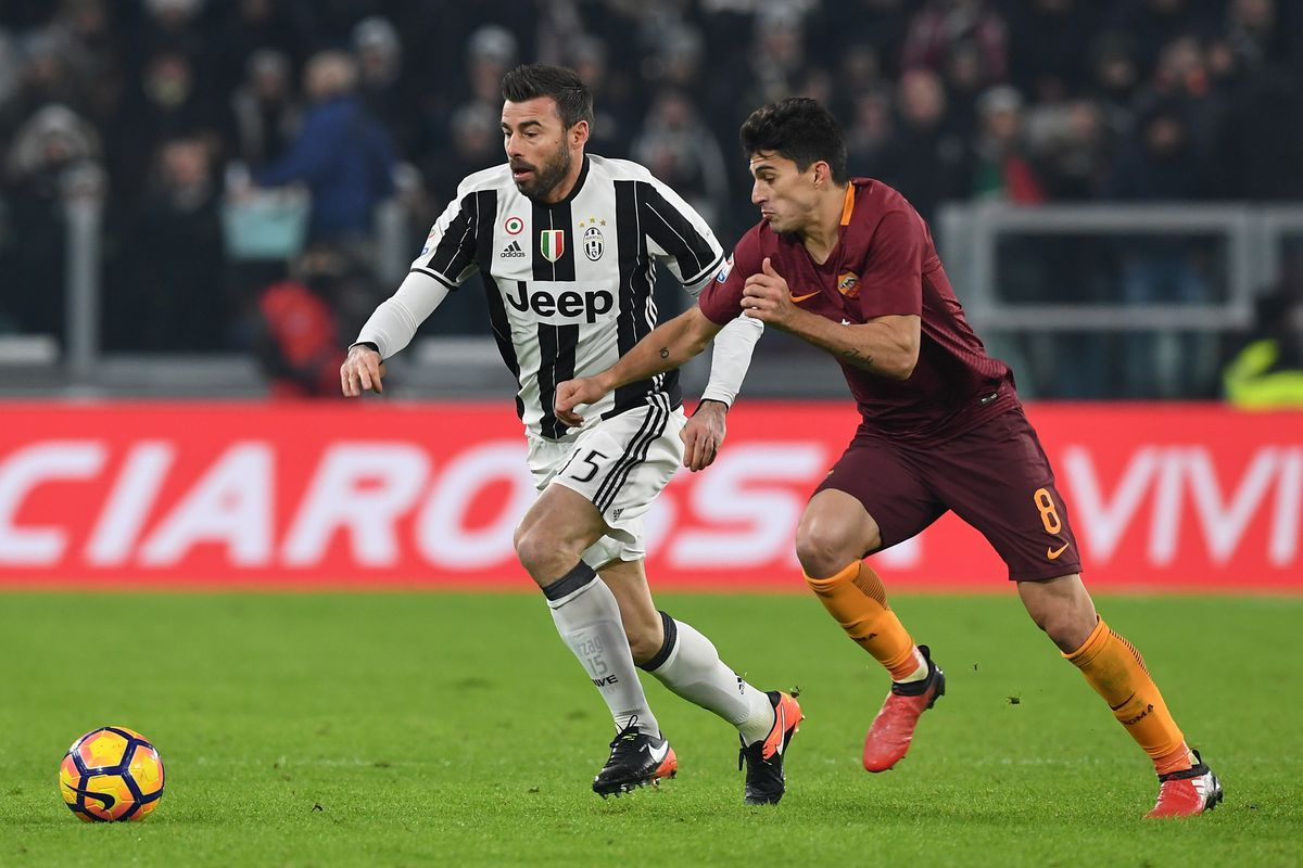 Andrea Barzagli Of Juventus Possesses The Ball Against As Romasgo Perotti On December  Photo By Valerio Pennicino Getty Images