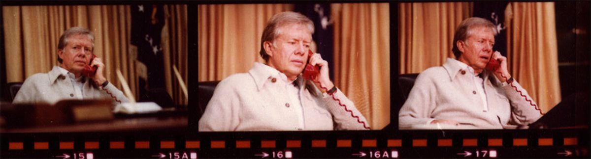 President Carter talking on the red phone.