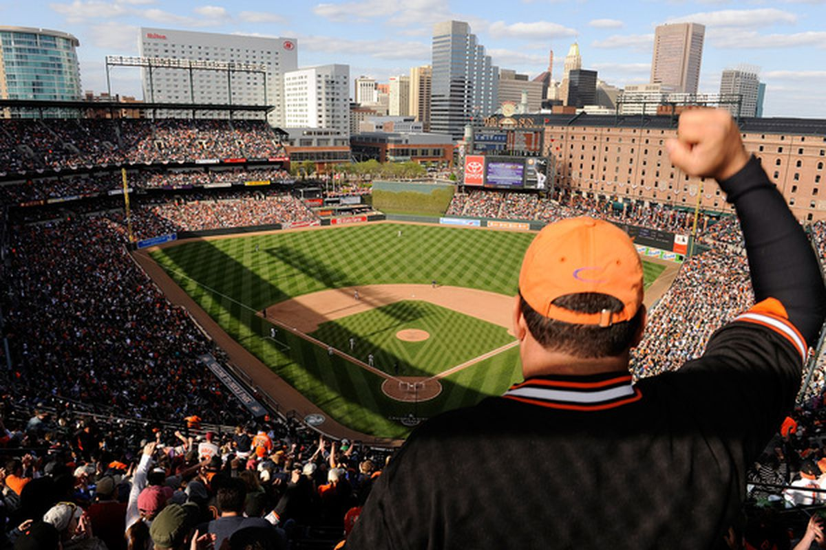 BALTIMORE - APRIL 09:  Fans cheer during the game between the Baltimore Orioles and the Toronto Blue Jays on Opening Day at Camden Yards on April 9, 2010 in Baltimore, Maryland.  (Photo by Greg Fiume/Getty Images)