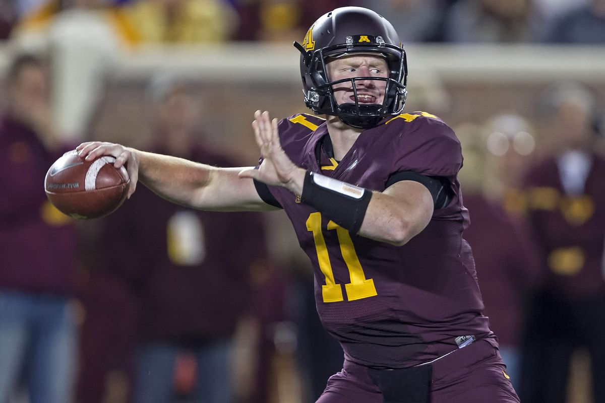 Sept 22, 2012; Minneapolis, MN, USA: Minnesota Golden Gophers quarterback Max Shortell (11) drops back for a pass in the first half against the Syracuse Orange at TCF Bank Stadium. Mandatory Credit: Jesse Johnson-US PRESSWIRE