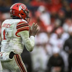 Utah Utes quarterback Tyler Huntley (1) uniform dirtied from  the game makes a call at the line of scrimmage in the third quarter at the Zaxby's Heart of Dallas Bowl between the Utah Utes and the West Virginia Mountaineers in Dallas Texas on Tuesday, Dec. 26, 2017.