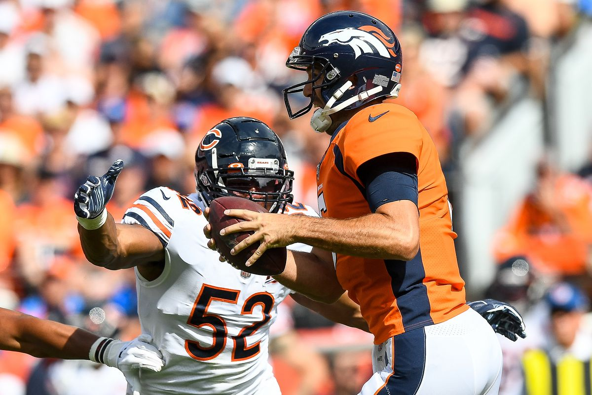 Joe Flacco of the Denver Broncos tries to avoid a sack by Khalil Mack of the Chicago Bears in the second quarter of a game at Empower Field at Mile High on September 15, 2019 in Denver, Colorado.