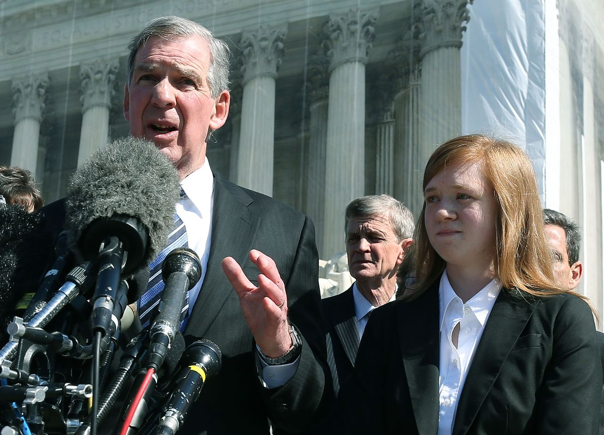 Fisher standing outside the Supreme Court