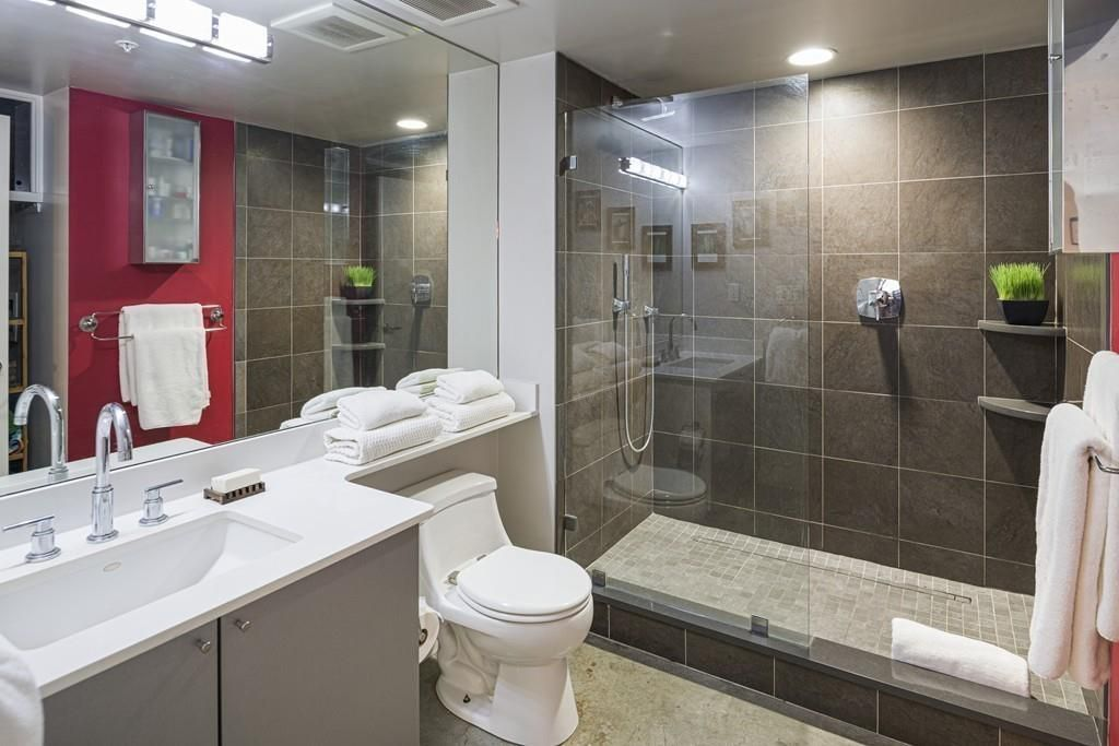 A shower with a glass half-door.
