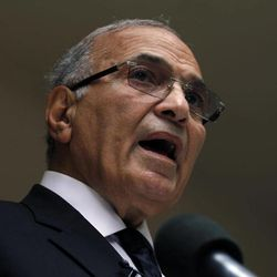 FILE - In this Saturday, May 26, 2012 file photo, Egyptian presidential candidate Ahmed Shafiq speaks to the media during a press conference at his office in Cairo, Egypt. Egyptian officials said Tuesday, Sept. 11, 2012 that Hosni Mubarak's last prime minister, Ahmed Shafiq, has been referred to trial on corruption charges in a case involving the ousted leader's sons.