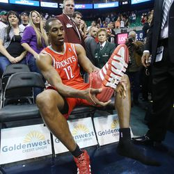 Houston's Dwight Howard takes off his shoes to give to fans after the game as Houston defeats the Jazz Saturday, Nov. 2, 2013 in EnergySolutions Arena. The Jazz lost 104-93.