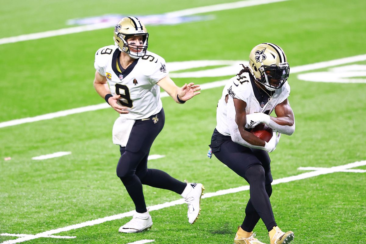 Drew Brees of the New Orleans Saints hands the ball off to Alvin Kamara of the New Orleans Saints in the fourth quarter against the Detroit Lions at Ford Field on October 4, 2020 in Detroit, Michigan.