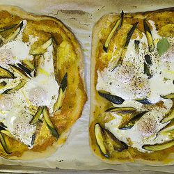 Zucchini pizza after final bake with egg on top