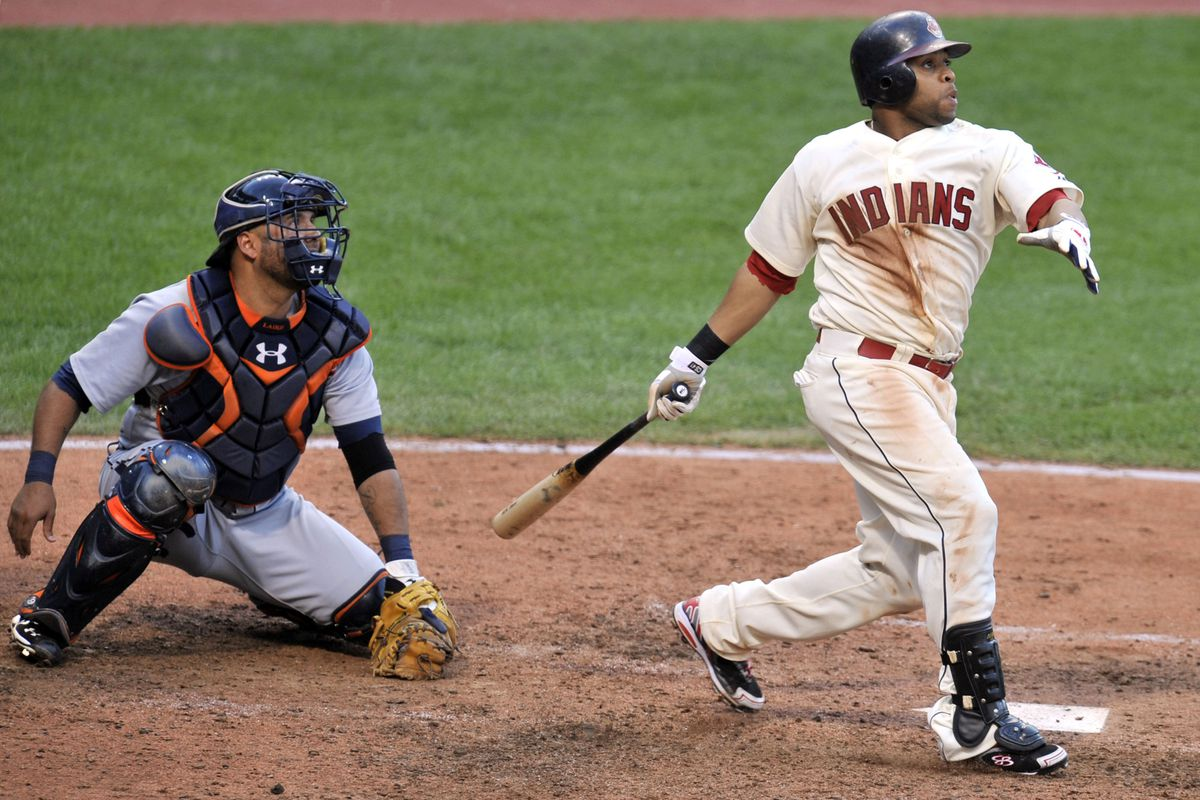 Sep 16, 2012; Cleveland, OH, USA; Detroit Tigers catcher Gerald Laird (9) watches as Cleveland Indians catcher Carlos Santana (41) hits a triple in the ninth inning at Progressive Field. Mandatory Credit: David Richard-US PRESSWIRE