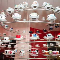 """illy art director Carlo Bach designed these """"chandeliers"""" to include 96 limited edition artist designed espresso cups."""