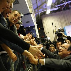 Socialist Party candidate for the presidential election Francois Hollande greets supporters after delivering his speech in Tulle, central France, Sunday, April 22, 2012. Official partial results show Socialist Francois Hollande and conservative President Nicolas Sarkozy are advancing to the runoff of France's presidential elections.