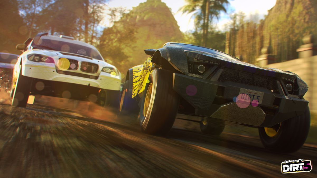 heavy vehicles race through a tropical setting in Dirt 5