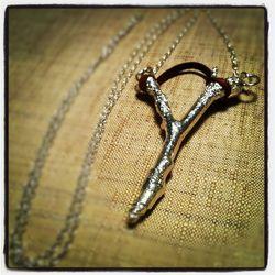 "<a href=""http://www.etsy.com/listing/119032773/slingshot-necklace-sterling-silver?"">Sterling Silver Slingshot Necklace</a>, $108"