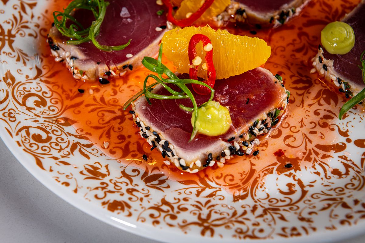 Seared tuna with avocado mousse, citrus, pickled fresno chiles, green onions, sesame seeds, and blood orange sodafrom Ada's