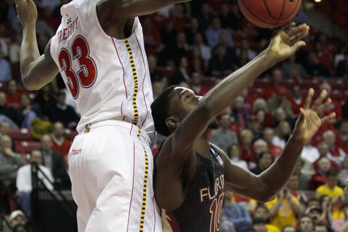 COLLEGE PARK MD - FEBRUARY 23: Dinio Gregory #33 of the  Maryland Terrapins blocks a shot by Okaro White #3 of the Florida State Seminoles at the Comast Center on February 23 2011 in College Park Maryland.  (Photo by Rob Carr/Getty Images)