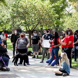 Protesters rally outside the Ogden Municipal Building in Ogden on Saturday, Sept. 12, 2020. People gathered to protest and call attention to the shooting of Linden Cameron, a 13-year-old with Asperger's syndrome who was shot by police in Salt Lake City.
